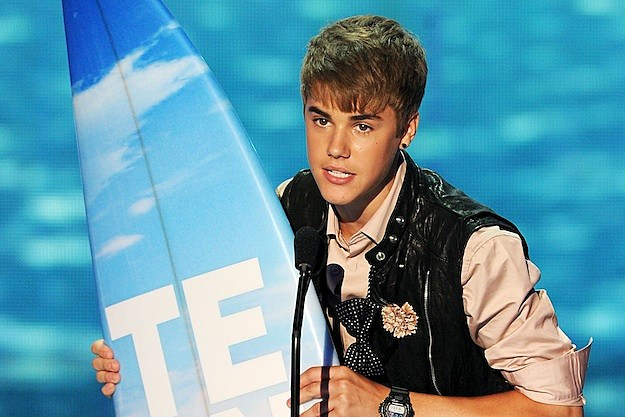 Justin Bieber earned four honors at the 2011 Teen Choice Awards , but