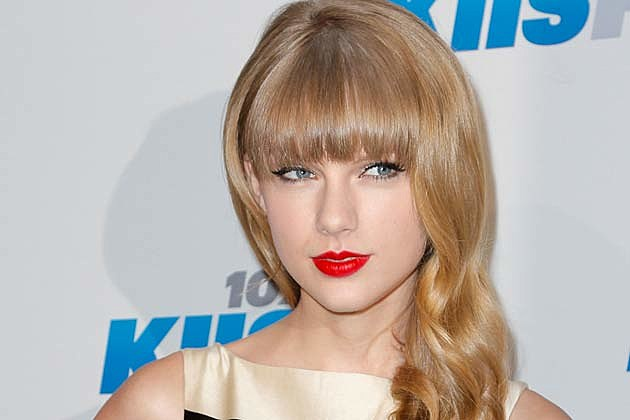 Taylor Swift Channels Coco Chanel in Striped Dress on Jingle Ball Red Carpet