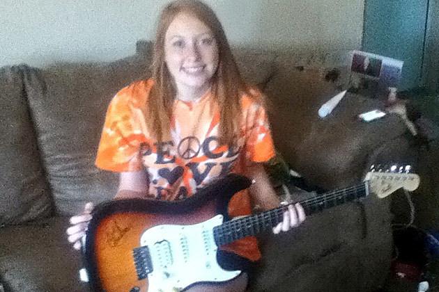Meet the Winner of PopCrush's Kelly Clarkson Guitar Giveaway!