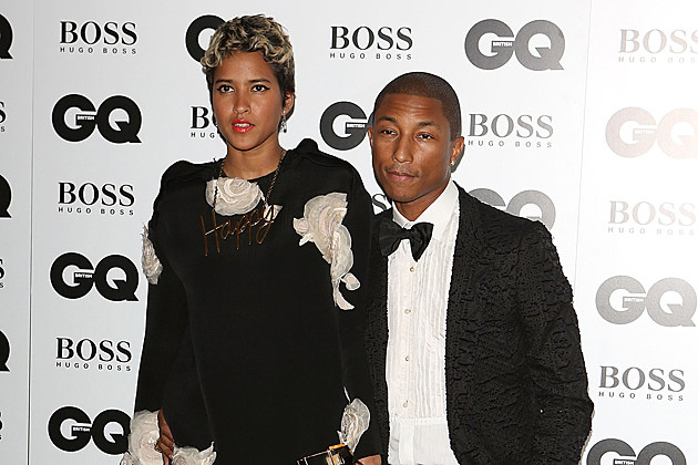 LONDON, ENGLAND - SEPTEMBER 03: Pharrell Williams (R) and Helen Lasichanh attend the GQ Men of the Year awards at The Royal Opera House on September 3, 2013 in London, England. (Photo by Tim P. Whitby/Getty Images)