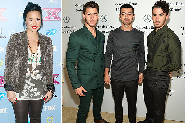 LOS ANGELES, CA - NOVEMBER 04: Singer Demi Lovato attends Fox's 'The X Factor' Finalist Party at the SLS Hotel on November 4, 2013 in Los Angeles, California. (Photo by Frederick M. Brown/Getty Images) / NEW YORK, NY - SEPTEMBER 05: (L-R) Nick Jonas, Joe Jonas, and Kevin Jonas of the Jonas Brothers attend the Mercedes-Benz Star Lounge during Mercedes-Benz Fashion Week Spring 2014 at Lincoln Center on September 5, 2013 in New York City. (Photo by Mike Coppola/Getty Images for Mercedes-Benz)