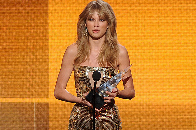 LOS ANGELES, CA - NOVEMBER 24: Singer Taylor Swift accepts the Favorite Country Album award for 'Red' onstage during the 2013 American Music Awards at Nokia Theatre L.A. Live on November 24, 2013 in Los Angeles, California. (Photo by Kevin Winter/Getty Images)