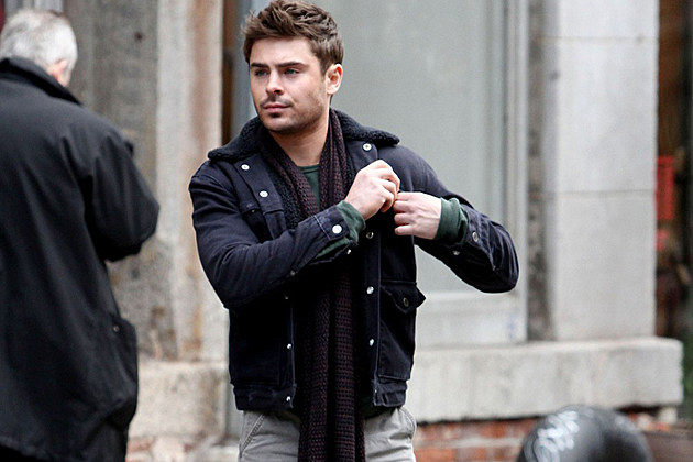 NEW YORK, NEW YORK - Thursday December 20, 2012. Zac Efron films scenes for 'Are We Officially Dating?' with co-star Imogen Poots in New York City. The dapper 'High School Musical' star kept warm with a coat and scarf as he shot street scenes in the city. Photograph: Lenny Abbot, ©PacificCoastNews.com