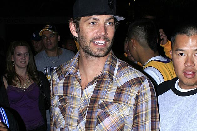 Paul Walker 's autopsy was initially delayed while the coroner