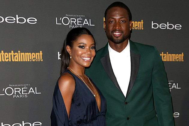 gabrielle-union-dwayne-wade-engaged WEST HOLLYWOOD, CA - SEPTEMBER 20: Gabrielle Union and Dwyane Wade arrive at Entertainment Weekly's Pre-Emmy Party at Fig & Olive Melrose Place on September 20, 2013 in West Hollywood, California. (Photo by Frederick M. Brown/Getty Images)