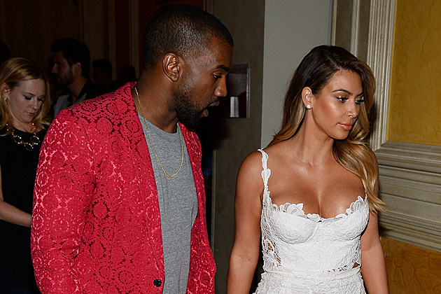 LAS VEGAS, NV - OCTOBER 26: Rapper Kanye West (L) and television personality Kim Kardashian arrive at the Tao Nightclub at The Venetian Las Vegas to celebrate Kardashian's 33rd birthday on October 26, 2013 in Las Vegas, Nevada. (Photo by Ethan Miller/Getty Images,)