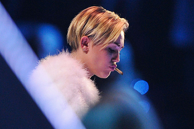 AMSTERDAM, NETHERLANDS - NOVEMBER 10: Miley Cyrus onstage during the MTV EMA's 2013 at the Ziggo Dome on November 10, 2013 in Amsterdam, Netherlands. (Photo by Gareth Cattermole/Getty Images for MTV) Horizontal, Netherlands, Amsterdam, Music, Award, Capital Cities, Arts Culture and Entertainment, Celebrities, MTV Europe Music Awards, Miley Cyrus, Ziggo Dome. Miley Cyrus smoking weed, Miley Cyrus marijuana, Miley Cyrus pot