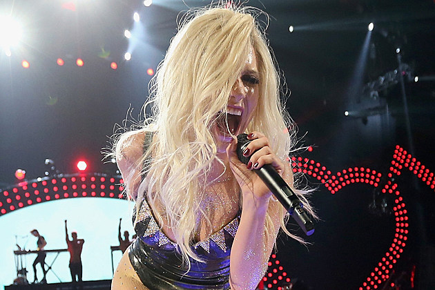 kesha-dr-luke LAS VEGAS, NV - SEPTEMBER 21: Singer Ke$ha performs onstage during the iHeartRadio Music Festival at the MGM Grand Garden Arena on September 21, 2013 in Las Vegas, Nevada. (Photo by Christopher Polk/Getty Images for Clear Channel)