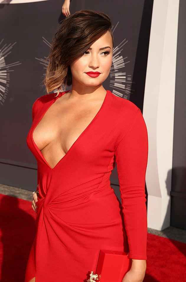 demi lovato shows off cleavage on 2014 mtv vmas red carpet