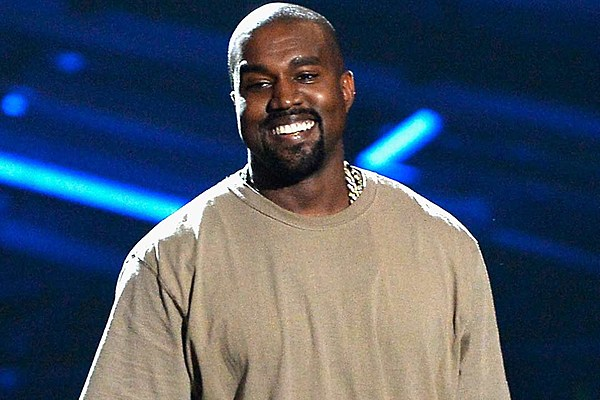 kanye west trolls the paparazzi with thank yous and smiles