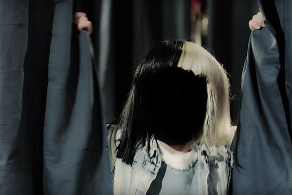 sia 39 s 39 move your body 39 video explores the origin story of her two toned wig. Black Bedroom Furniture Sets. Home Design Ideas