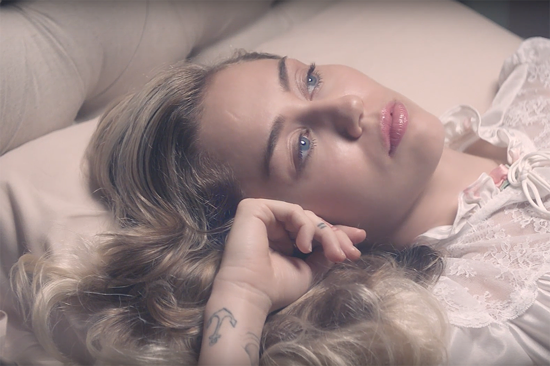 "Miley Cyrus in the video for ""Younger Now"""