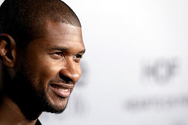 Usher smiling